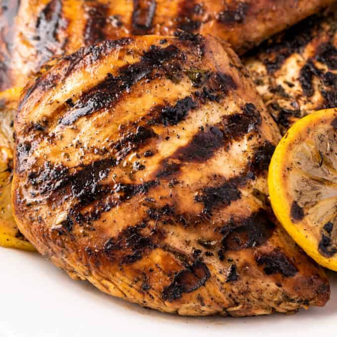 pile of grilled chicken on white plate