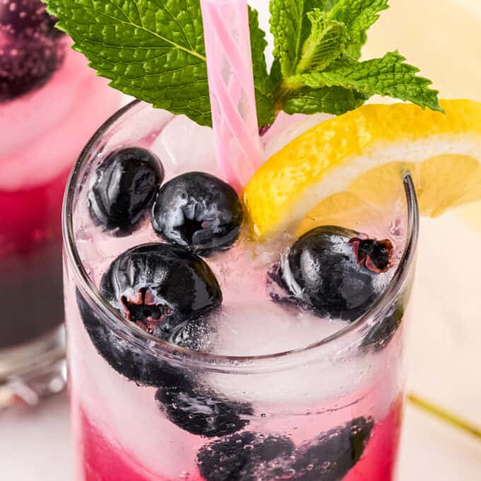 sparkling blueberry lemonade with straw