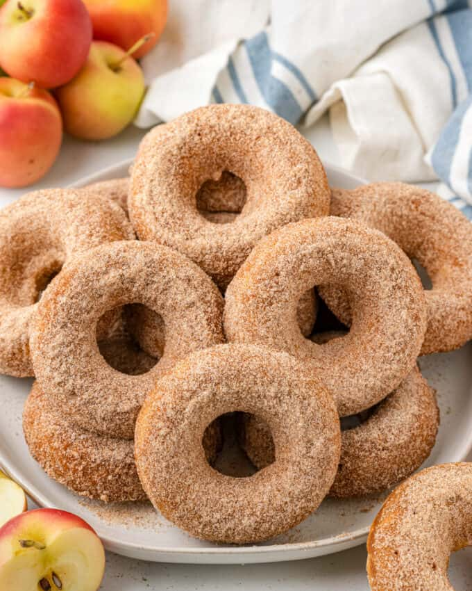pile of baked apple cider donuts on white plate