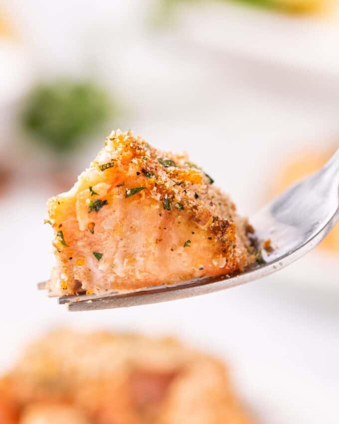 bite of baked salmon on fork