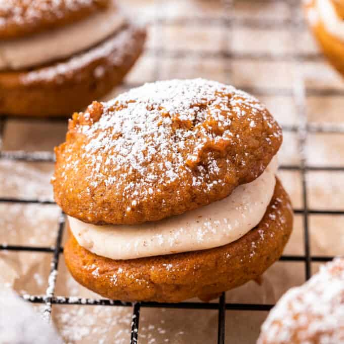 Soft and moist spiced pumpkin cookies sandwiched together with a browned butter maple buttercream that is out of this world delicious! They're the perfect Fall baking treat! #pumpkin #whoopiepies #pumpkinspice