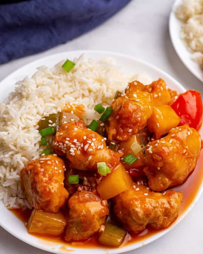 serving of sweet and sour chicken on plate with rice