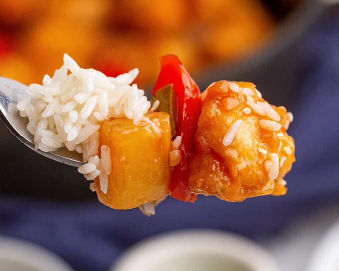 forkful of rice and sweet and sour chicken